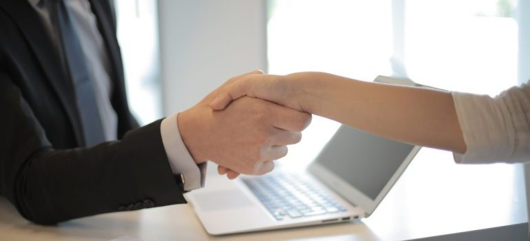 A person shaking hands with a professionals.