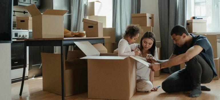 A family unpacking and getting ready to settle in their new home after a relocation.