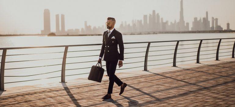 A classy businessman with a handbag