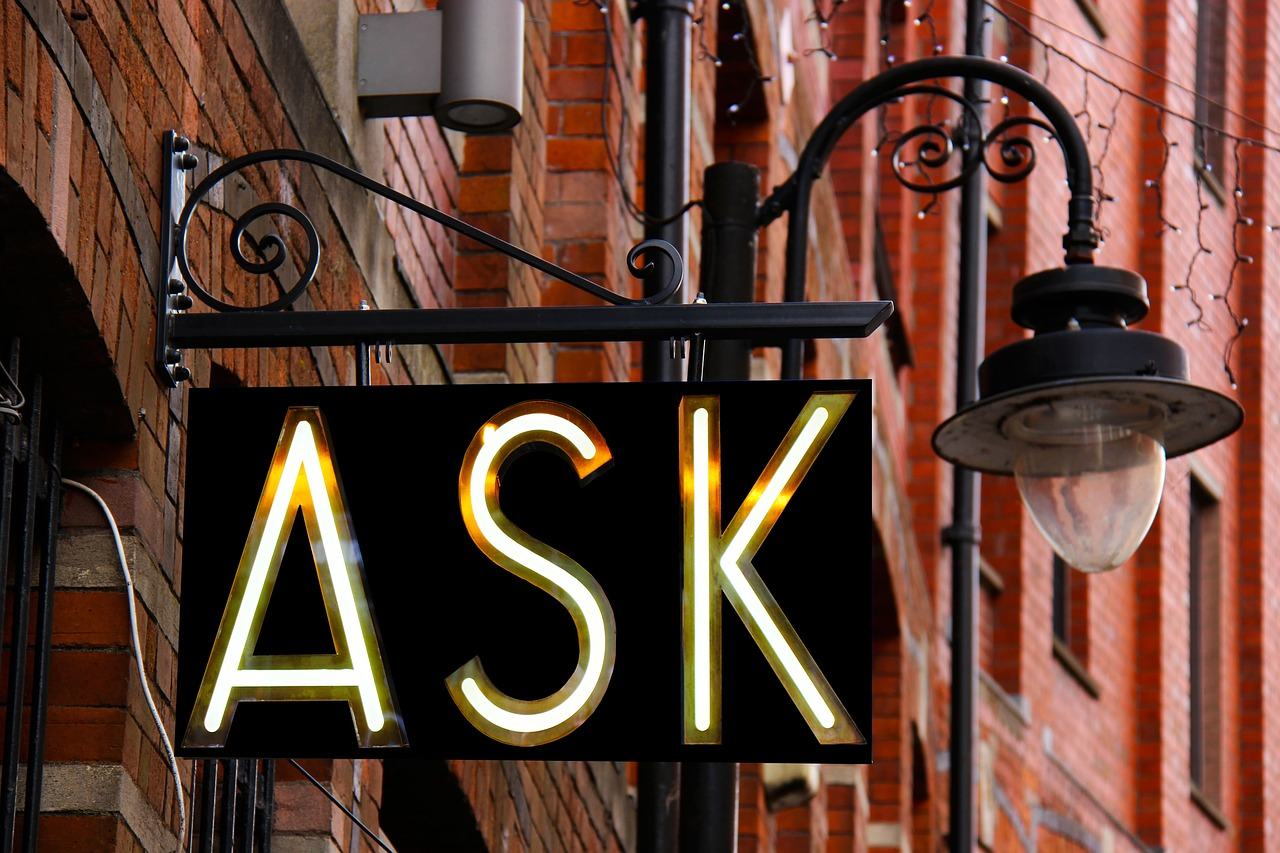 """A neon """"ASK"""" sign"""