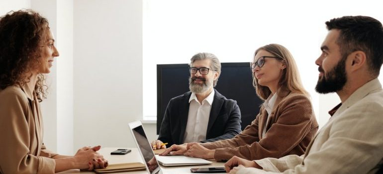 Businesspersons talking to a client