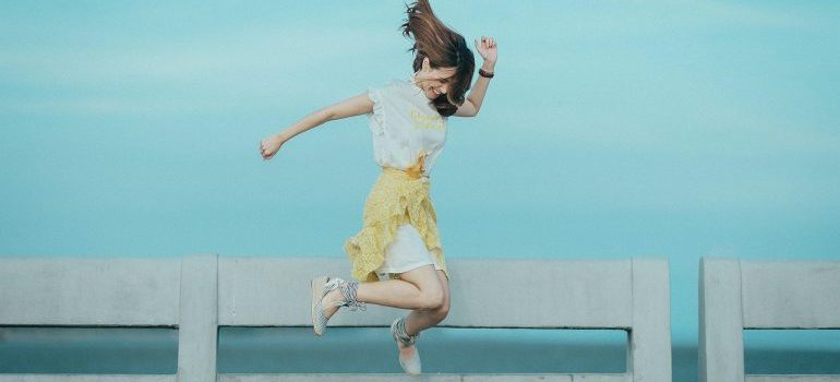 A woman jumping from joy.