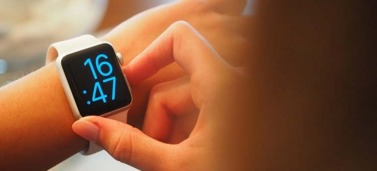 A person looking at her digital wrist watch.