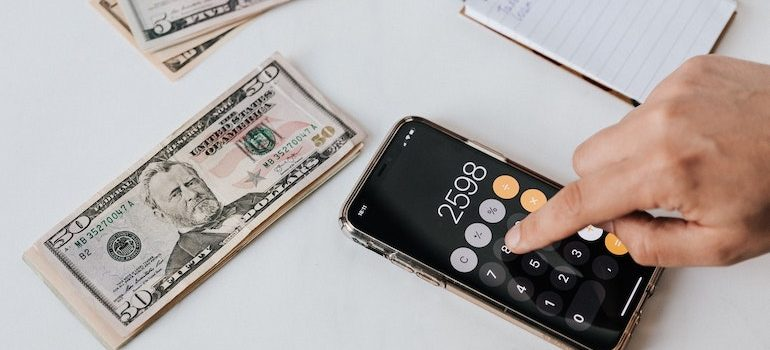 calculator next to money and notebook
