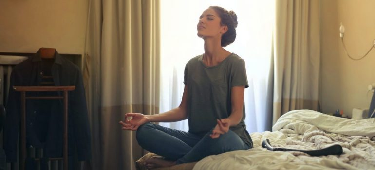 a woman meditating to mentally prepare for moving to Montgomery County